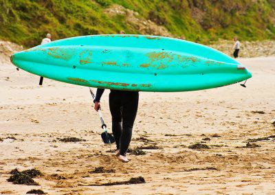 man carrying green canoe Ballybunion